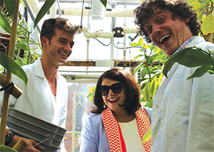 Ethan Marks (left) and Nate Kingsley (right) share Chancellor Davenport's excitement about the variety of plants in the greenhouse.